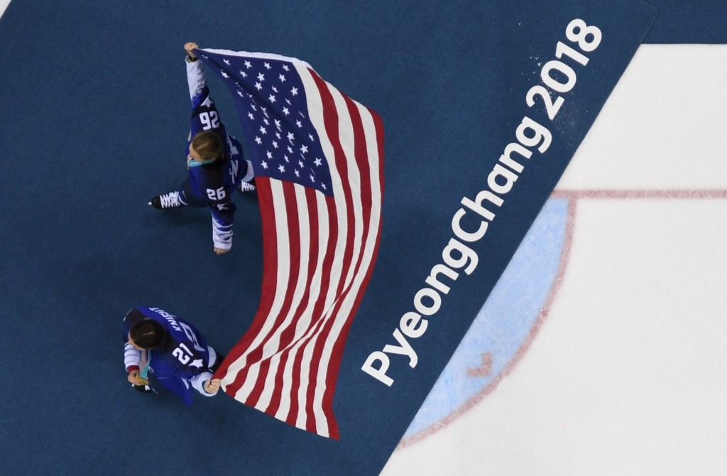Kendall Coyne (top) and Hilary Knight of the U.S. after winning gold medal in women's ice hockey. BRENDAN SMIALOWSKI/AFP/Getty Images