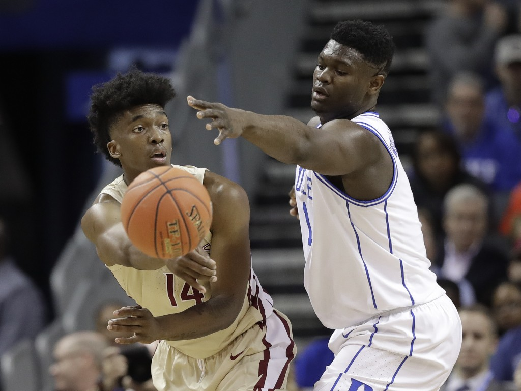 Florida State's Terance Mann (14) passes the ball as Duke's Zion Williamson (1) defends during the first half of the NCAA college basketball championship game of the Atlantic Coast Conference tournament in Charlotte, N.C., Saturday, March 16, 2019. (AP Photo/Chuck Burton)
