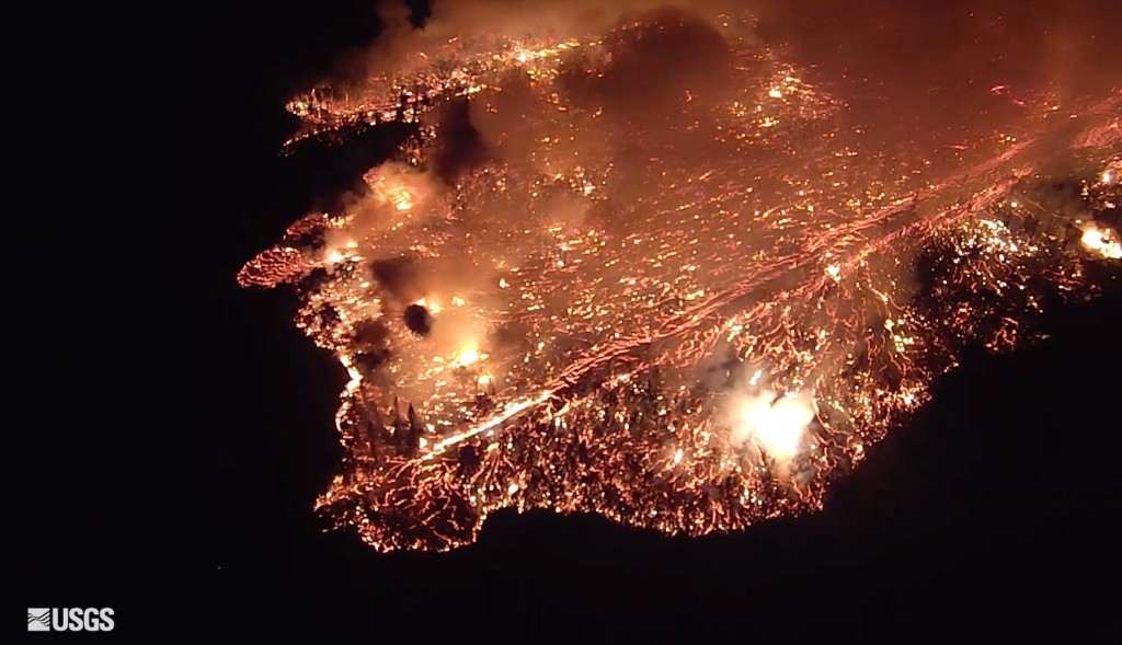 An outbreak of lava rapidly moving down Luana Street into a portion of Leilani Estates on the island of Hawaii. U.S. Geological Survey via AP