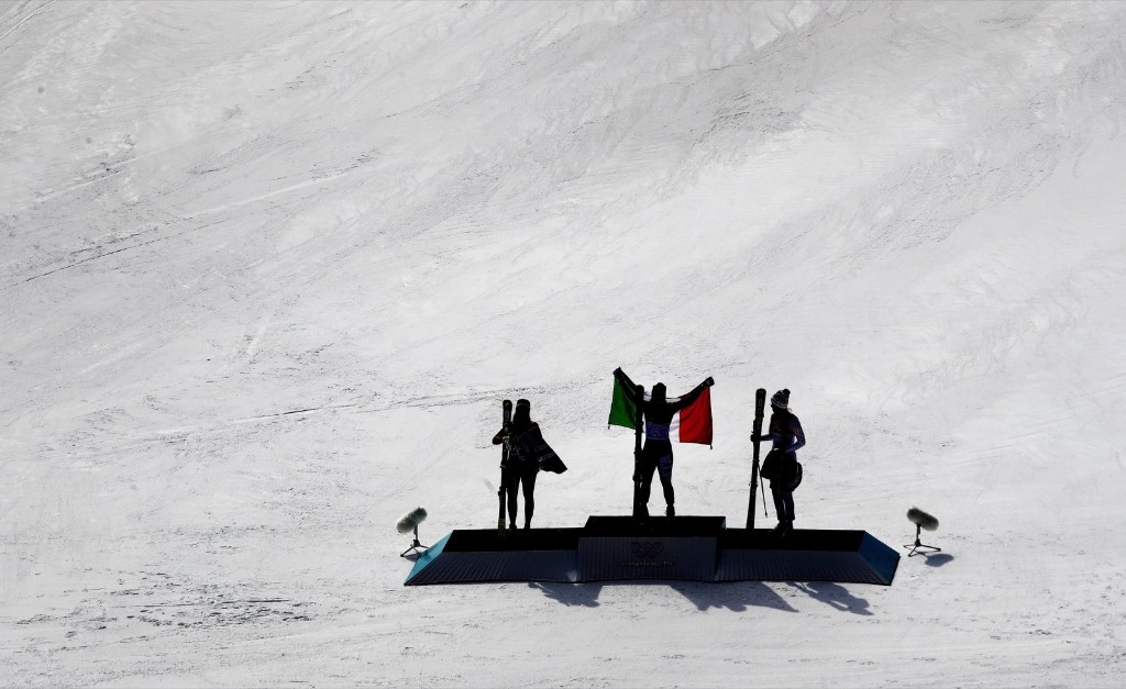 Norway's Ragnhild Mowinckel, Italy's Sofia Goggia and Lindsey Vonn during the venue ceremony for the women's downhill. AP Photo/Charlie Riedel