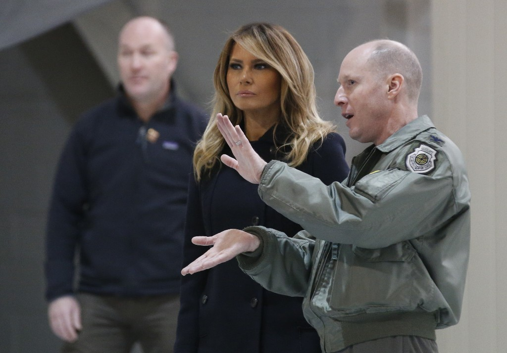 First lady Melania Trump, front left, talks with Col. Jason Hinds, Commander of the First Fighter Wing as he gives her a tour of an F22 fighter at Joint Base Langley in Hampton, Va., Wednesday, Dec. 12, 2018. (AP Photo/Steve Helber)