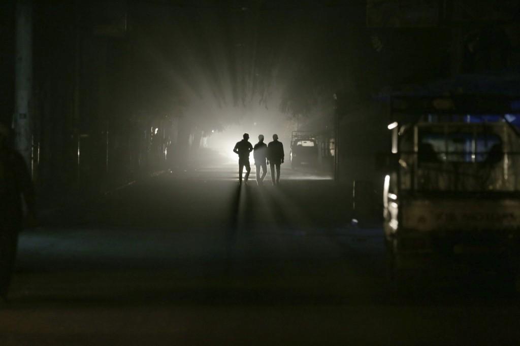Men walk along a street at night in eastern al-Ghouta, near Damascus. REUTERS/Bassam Khabieh