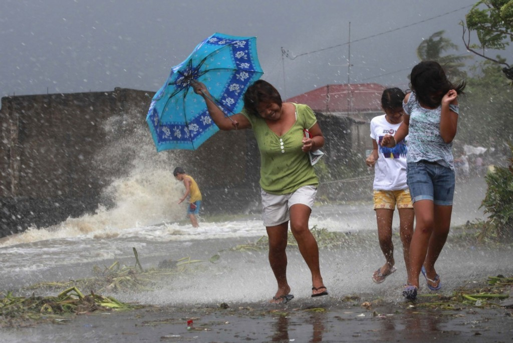Residents walk along the coastal village of Bayog in Los Banos, Laguna, south of Manila. REUTERS/Charlie Saceda