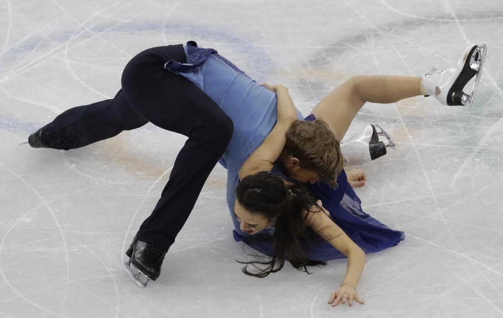Madison Chock and Evan Bates of the U.S. stumble and fall during ice dance. AP Photo/Bernat Armangue
