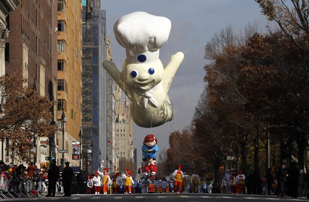The Pillsbury Doughboy balloon floats down Central Park West in the Macy's Thanksgiving Day Parade in New York, Thursday. Photo by Gary Hershorn