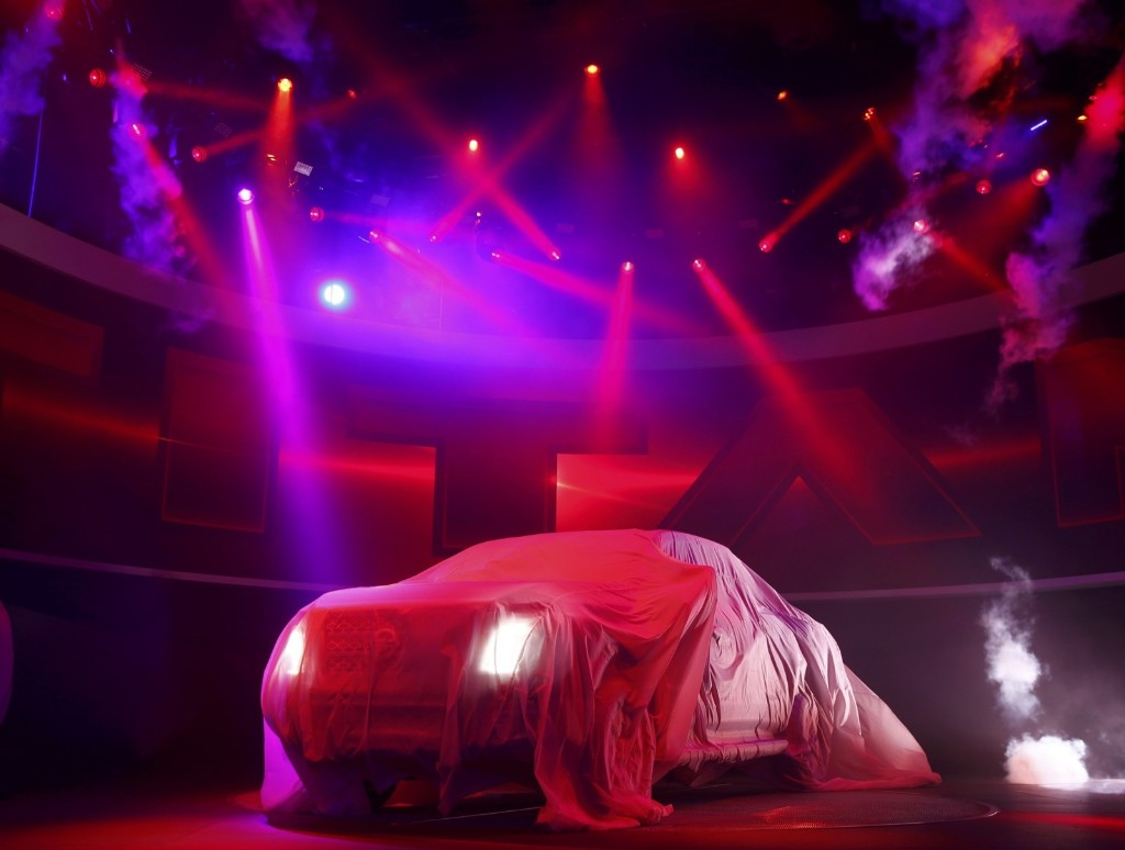 The 2016 Nissan Titan pickup truck is shown under a cover at the North American International Auto Show in Detroit, Monday. REUTERS/Mark Blinch