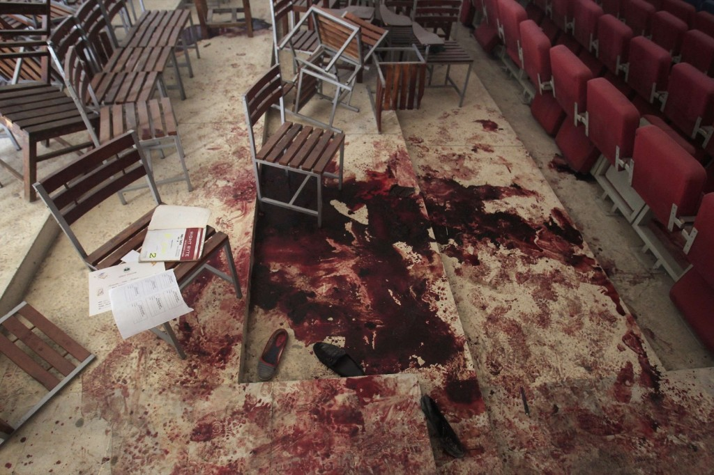 The scene in the auditorium at the Army Public School after the Taliban attack in Peshawar. REUTERS/Fayaz Aziz