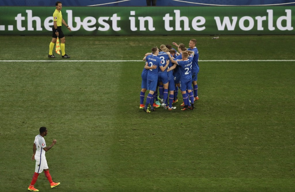 Iceland players congratulate their teammate Kolbeinn Sigthorsson after he scored against England in Euro 2016. AP Photo/Ariel Schalit