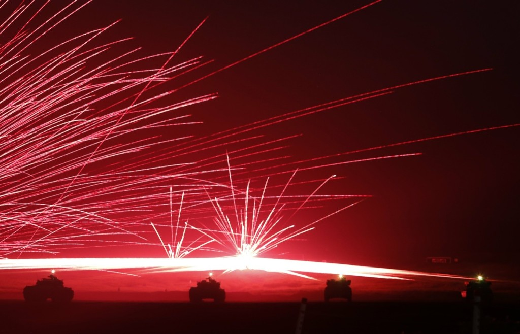 Tracer bullets ricochet off their targets as Japanese Ground Self-Defence Force tanks fire their machine guns during a training exercise near Mount Fuji. REUTERS/Yuya Shino