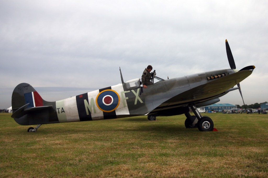 A pilot climbs into a Spitfire, Tuesday, in Biggin Hill, England. Carl Court/Getty Images