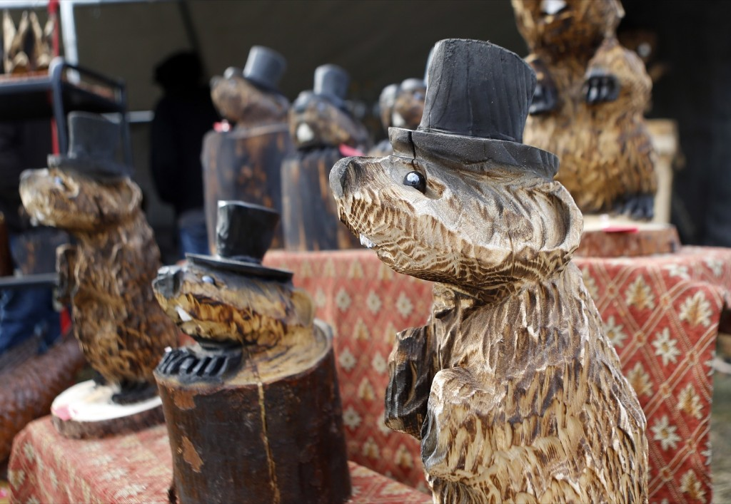 Wooden carvings of groundhogs are for sale at an annual craft show in the square in Punxsutawney, Pa. AP Photo/Keith Srakocic