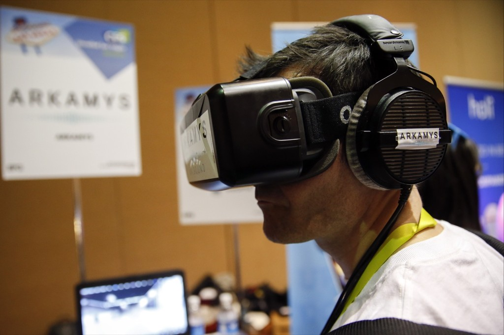 The Oculus VR Inc. virtual reality headset and Beyerdynamic GmbH headphones. Patrick T. Fallon/Bloomberg/Getty Images
