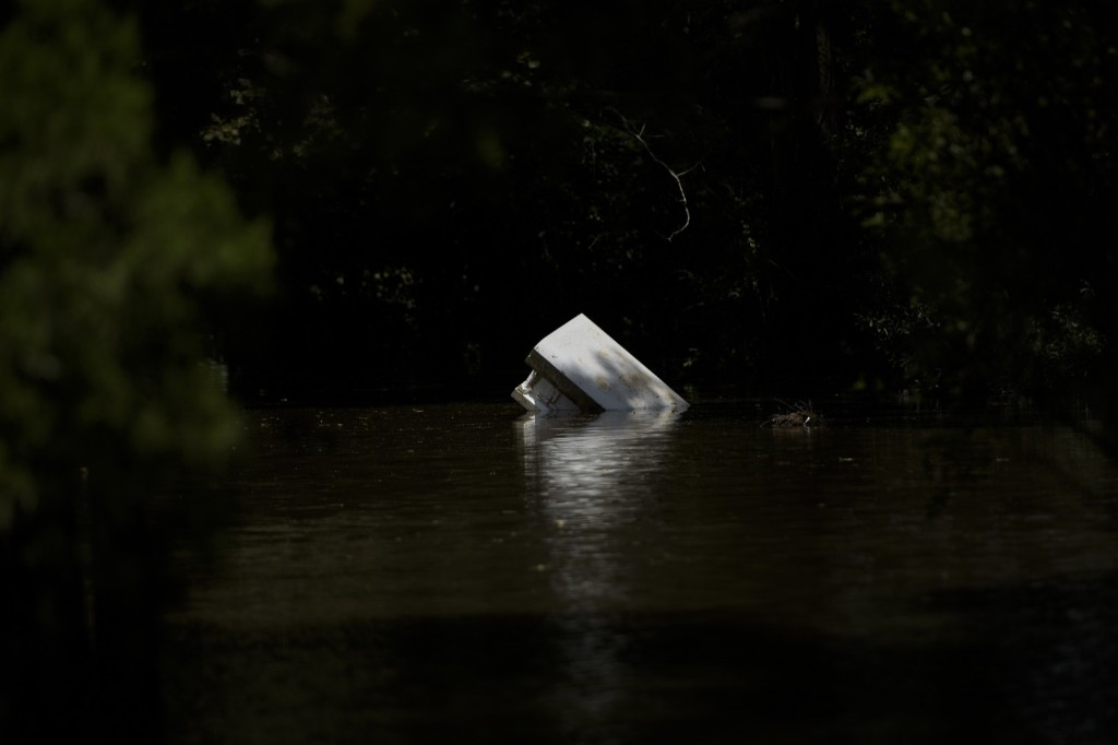 An above ground tomb floats after flooding in Gonzales, La. BRENDAN SMIALOWSKI/AFP/Getty Images