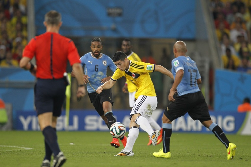James Rodriguez slamming in Colombia's first goal against Uruguay. Gary Hershorn/Flipboard