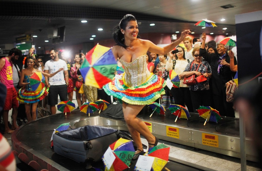 Carnival dancers perform for people arriving in the baggage claim area at Guararapes Gilberto Freyre International Airport in Recife. Mario Tama/Getty Images