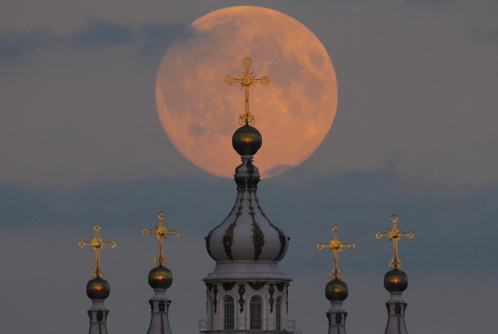 Harvest moon rising above the domes of the Smolny Cathedral in St. Petersburg. AP Photo/Dmitry Lovetsky