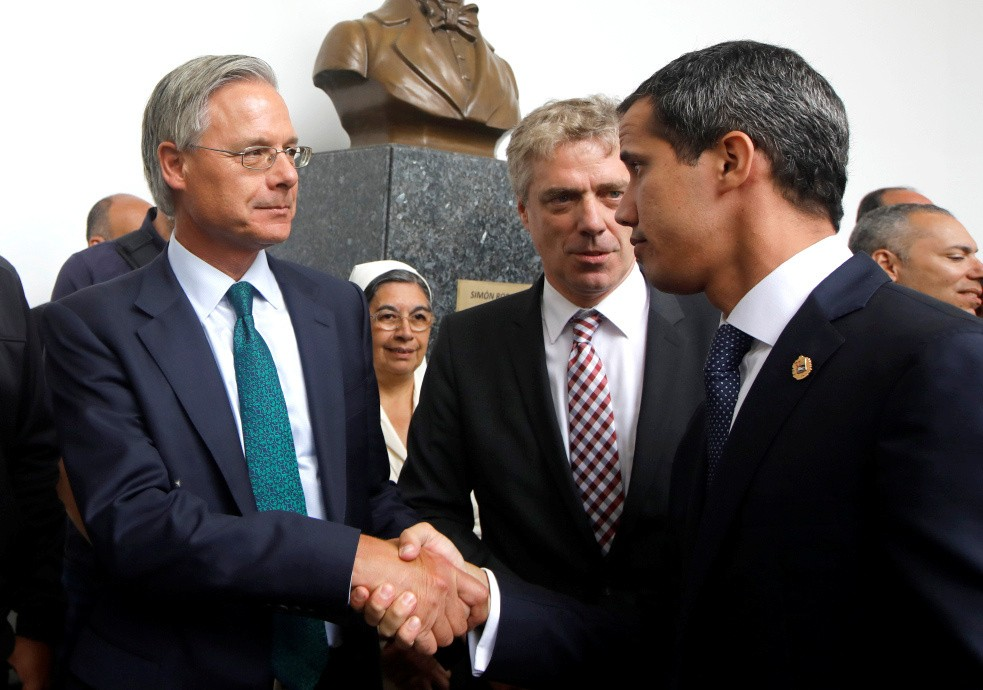 British ambassador to Venezuela Andrew Keith Sope, next to German ambassador to Venezuela Daniel Martin Kriener, and Venezuelan opposition leader Juan Guaido, who many nations have recognized as the country's rightful interim ruler, shake hands during a news conference with accredited diplomatic representatives of the European Union in Caracas, Venezuela February 19, 2019. REUTERS/Marco Bello
