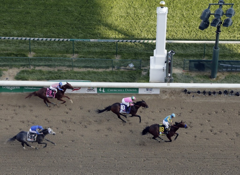 Victor Espinoza rides American Pharoah to victory in the 141st running of the Kentucky Derby, at Churchill Downs, Saturday, in Louisville. AP Photo/Charlie Riedel