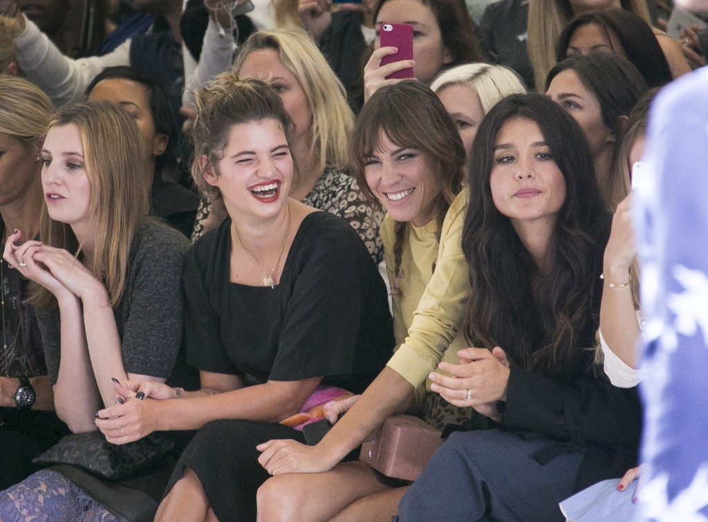 Pixie Geldof, left, and Alexa Chung, centre right, share a joke as they watch the Topshop show. Joel Ryan/Invision/AP