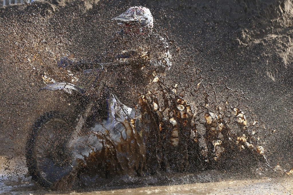A competitor ploughs through heavy conditions during the 32nd running of the RHL Weston Beach Race in Somerset. Michael Steele/Getty Images