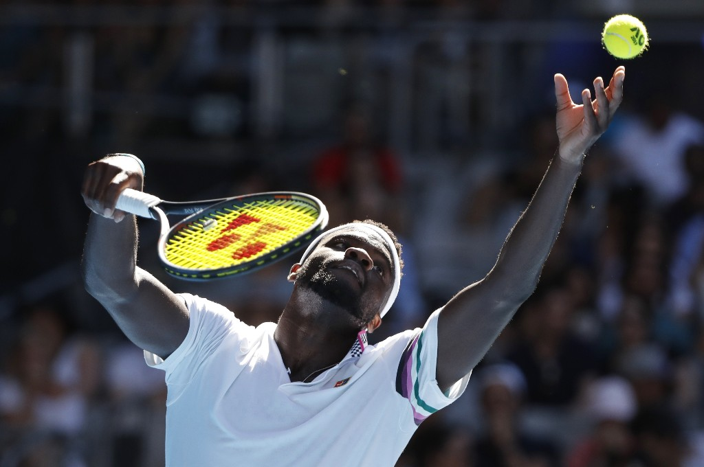 Tennis - Australian Open - Fourth Round - Melbourne Park, Melbourne, Australia, January 20, 2019. Frances Tiafoe of the U.S. serves during the match against Bulgaria's Grigor Dimitrov. REUTERS/Aly Song