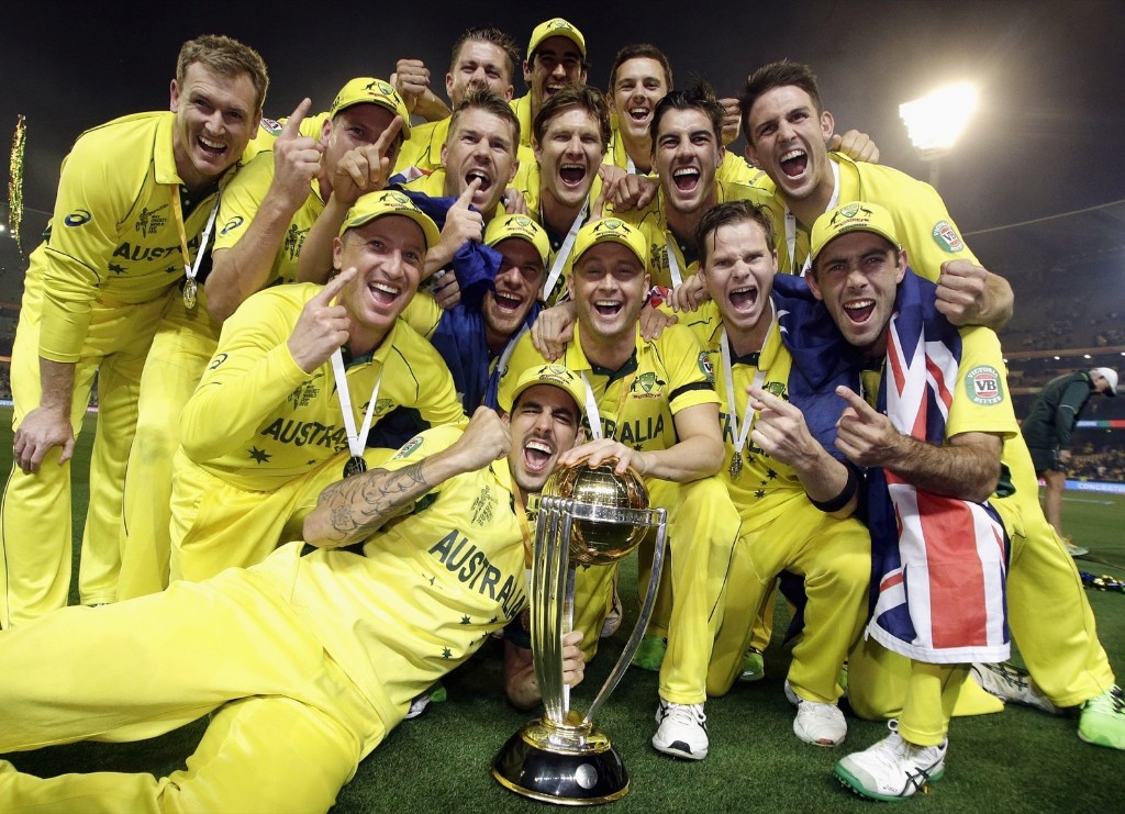 Australia's captain Michael Clarke and teammates with the Cricket World Cup trophy after they defeated New Zealand in the final match, in Melbourne, Sunday. REUTERS/Hamish Blair