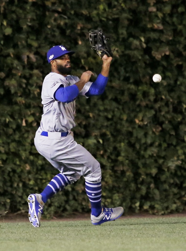Dodger left fielder Andrew Toles dropping fly ball hit by Cubs Anthony Rizzo during the first inning. The error proved fateful. AP Photo/Nam Y. Huh