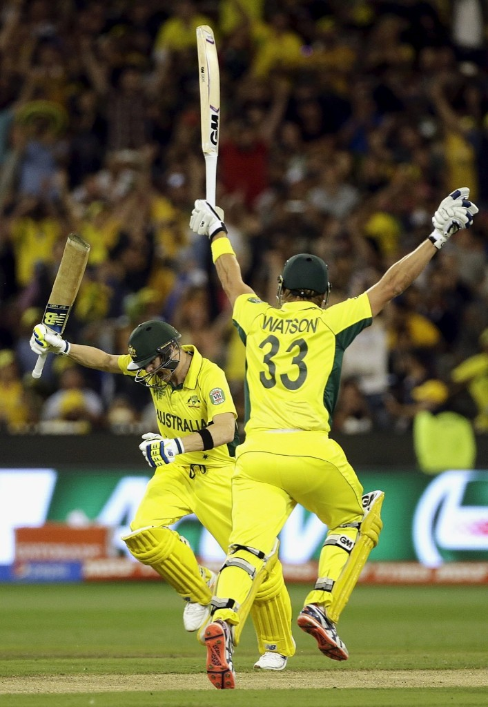Australia's Steven Smith celebrates with team mate Shane Watson after he hit the winning runs to defeat New Zealand in their Cricket World Cup final match, in Melbourne, Sunday. REUTERS/Hamish Blair