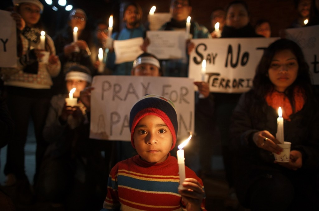 A candle light vigil in Kathmandu for the students killed at the military-run Army Public School in Peshawar. REUTERS/Navesh Chitrakar