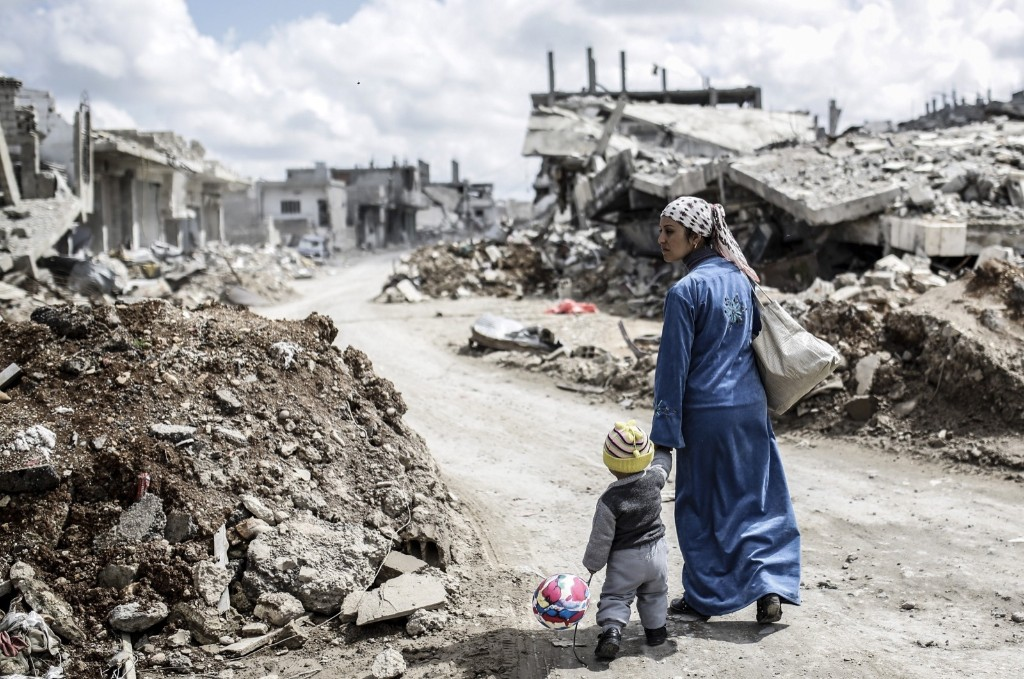 A Kurdish Syrian woman with her child in Kobane. YASIN AKGUL/AFP/Getty Images