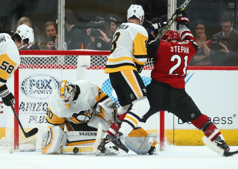 Jan 18, 2019; Glendale, AZ, USA; Pittsburgh Penguins goalie Matt Murray (30) makes a save against the Arizona Coyotes in the first period at Gila River Arena. Mandatory Credit: Mark J. Rebilas-USA TODAY Sports