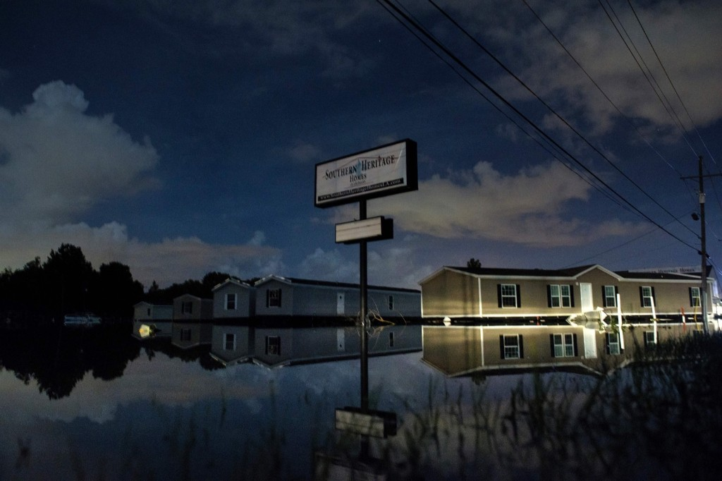 Prefabricated homes in flood waters at Southern Heritage Homes in Denham Springs, La. BRENDAN SMIALOWSKI/AFP/Getty Images