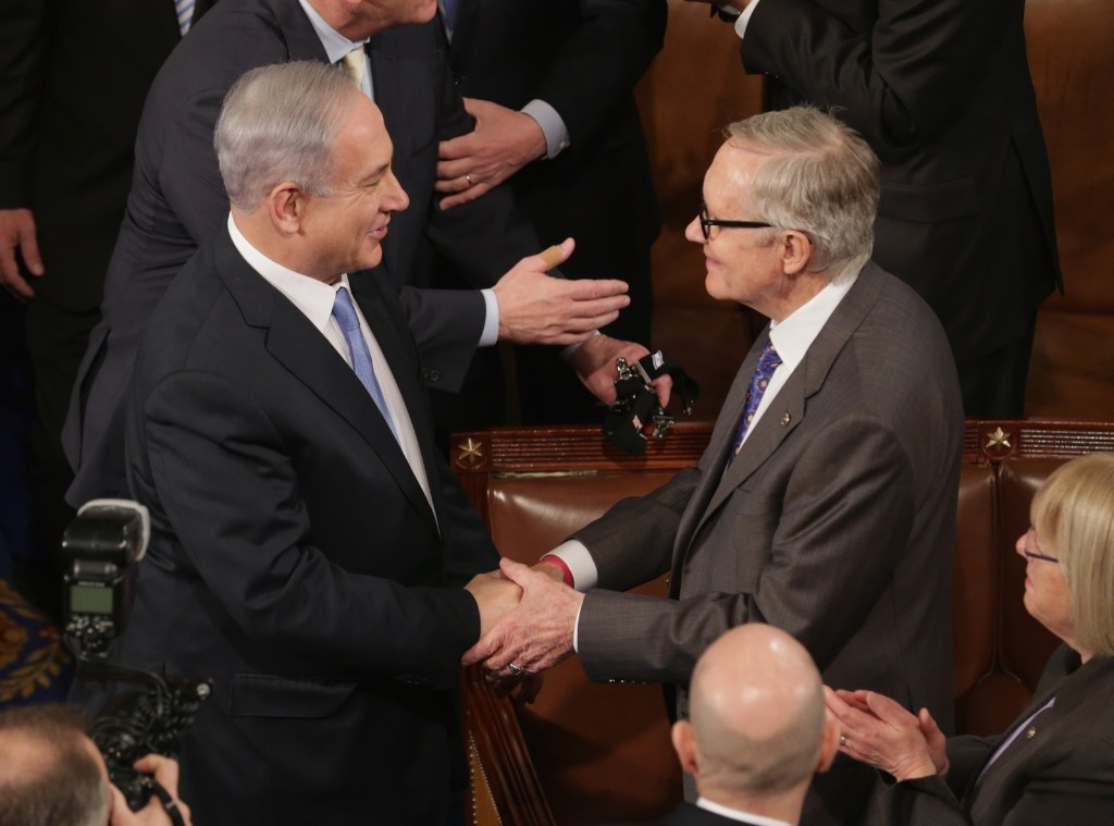 Israeli Prime Minister Benjamin Netanyahu greets Senate Minority Leader Harry Reid before speaking to a joint meeting of the U.S. Congress, Tuesday, in Washington. Chip Somodevilla/Getty Images