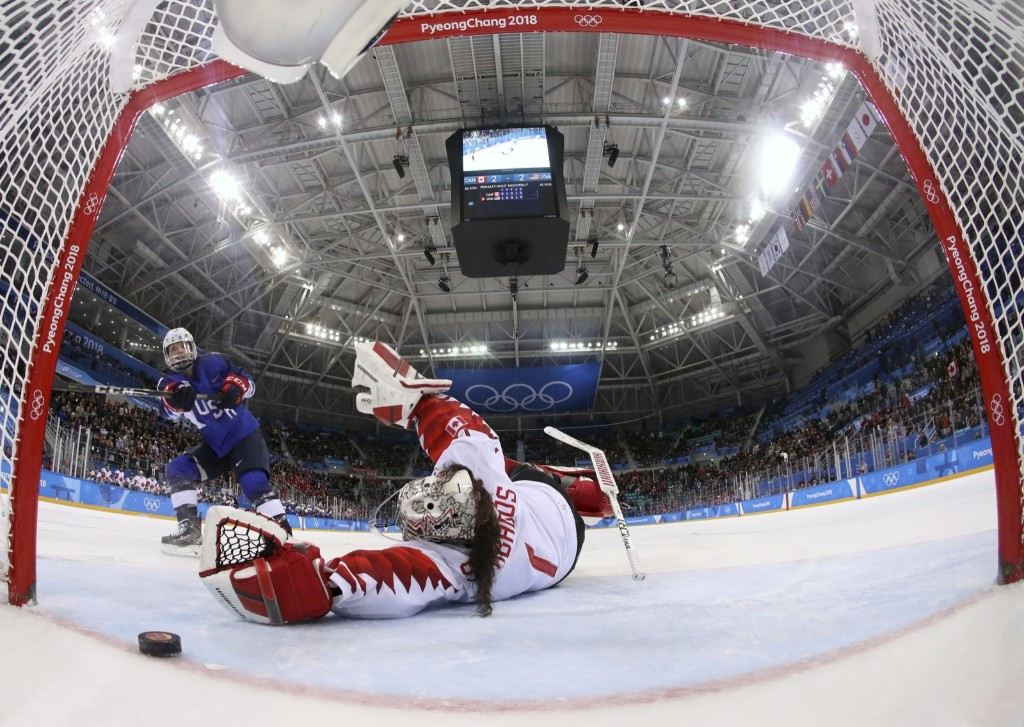 Jocelyne Lamoureux-Davidson of the U.S. scores the game-winning goal during shootout against goalie Shannon Szabados of Canada. Bruce Bennett/Pool Photo via AP