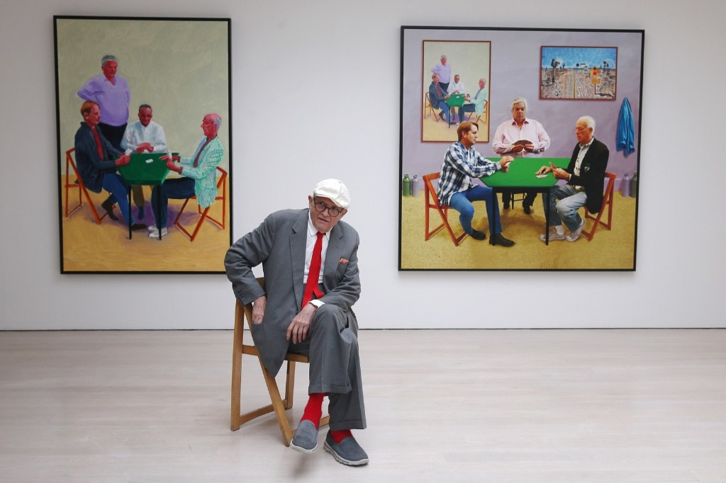 British artist David Hockney sits in front of two works entitled, 'Card Player #3 and Bigger Card Players', during the launch of his new exhibition at the Annely Juda fine art gallery in London. Dan Kitwood/Getty Images