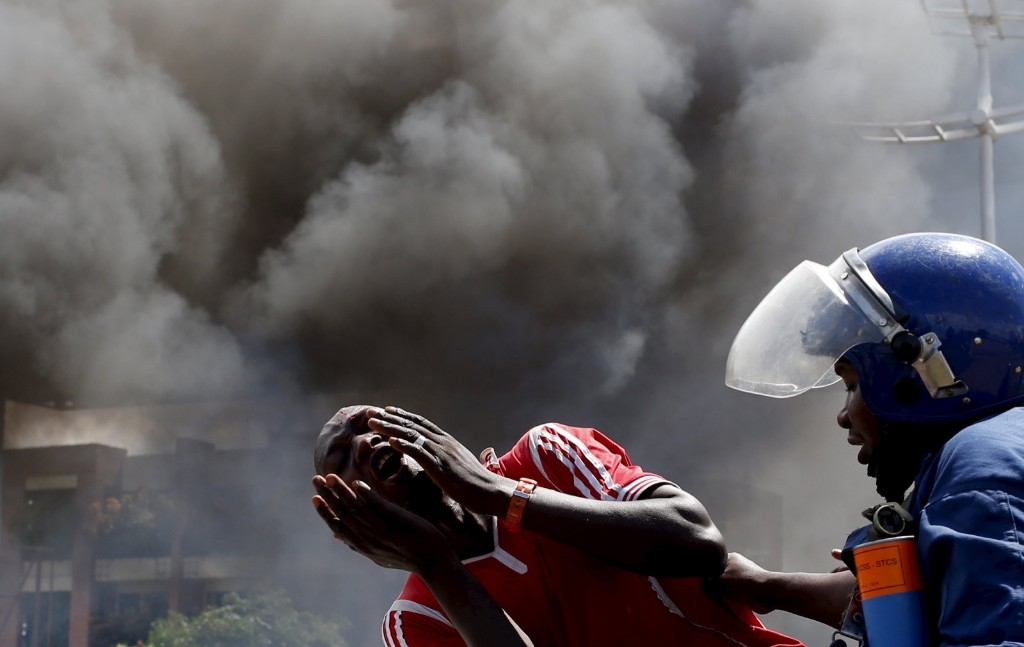 A detained protester cries in front of a burning barricade during a protest against President Pierre Nkurunziza's decision to run for a third term in Bujumbura, Burundi. REUTERS/Goran Tomasevic