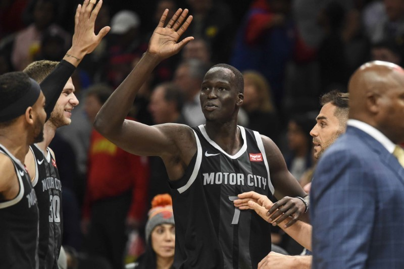 Feb 22, 2019; Atlanta, GA, USA; Detroit Pistons forward Thon Maker (7) reacts with teammates after making a three point basket to give the Pistons the lead with sixteen seconds left against the Atlanta Hawks during the second half at State Farm Arena. Mandatory Credit: Dale Zanine-USA TODAY Sports