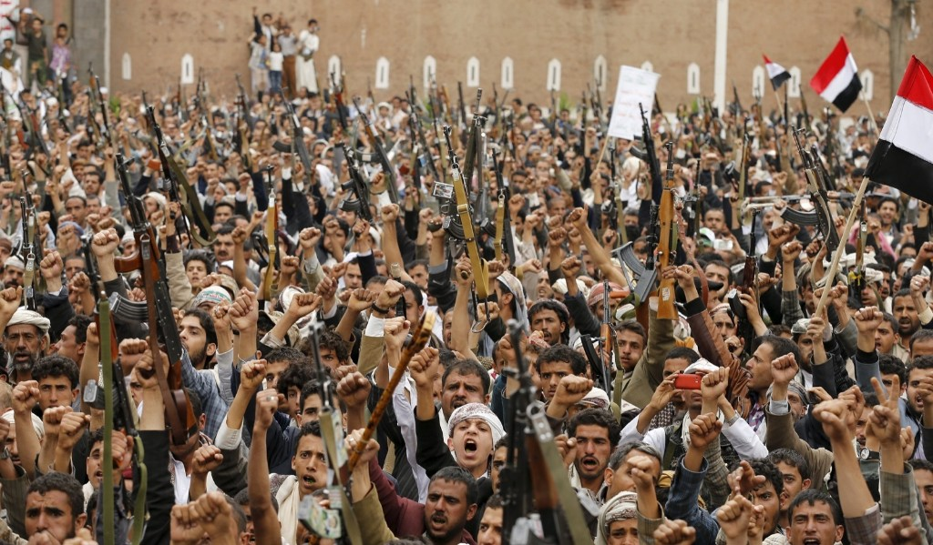 Shi'ite Muslim rebels hold up their weapons during a rally against air strikes in Sanaa. REUTERS/Khaled Abdullah