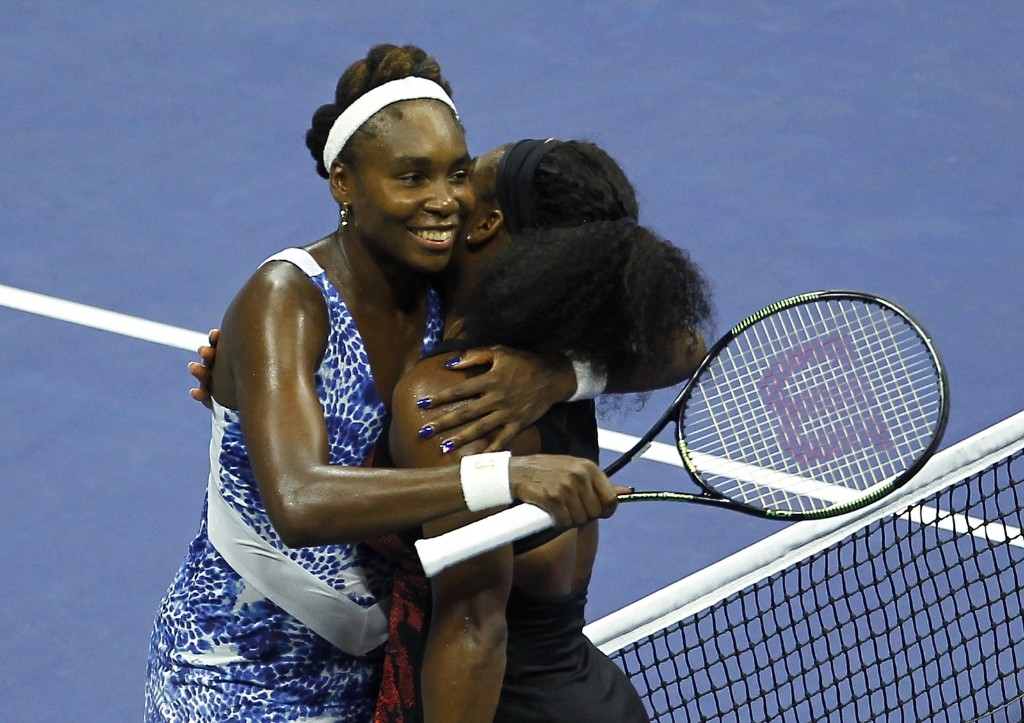 Serena Williams of the U.S. (R) embraces her sister Venus Williams at the net after defeating her in their match at the U.S. Open tennis tournament in New York, Tuesday. Gary Hershorn/Corbis