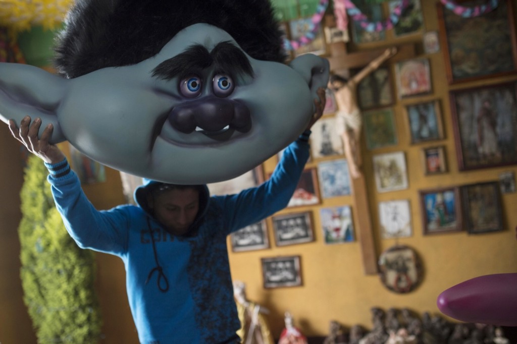 A member of the Saturn Club with his Trolls mask in Sumpango, Sacatepequez, near Guatemala City. AP Photo / Luis Soto