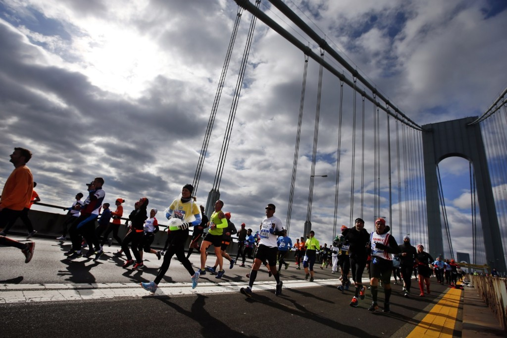 Runners cross the Verrazano-Narrows Bridge at the start of the marathon. AP Photo/Jason DeCrow