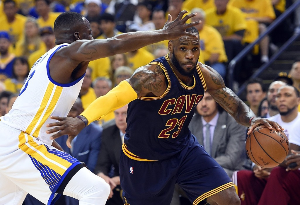 LeBron James drives to the basket against Warriors Draymond Green. Bob Donnan-USA TODAY Sports