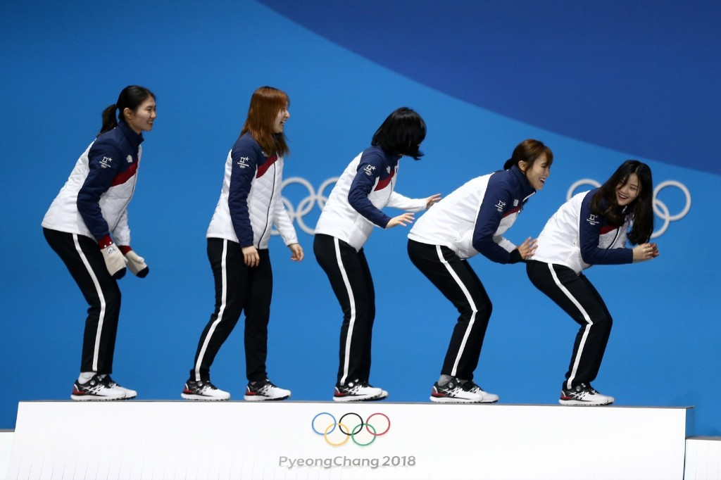 South Korea gold medalists celebrate with their medals after winning the 3000m relay in short track. Dan Istitene/Getty Images