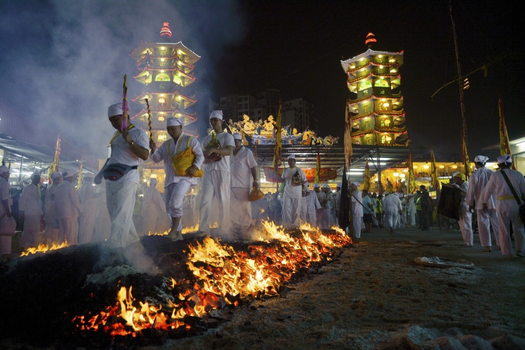Malaysian ethnic Chinese walk barefoot over burning coals on the final day of the Nine Emperor Gods festival near Kuala Lumpur. AP Photo
