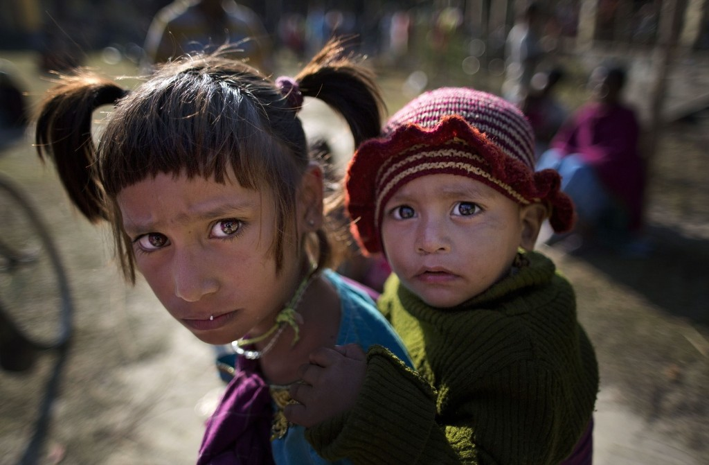 Indian tribal children at a relief camp at Tinsuti village in Sonitpur. AP Photo/Anupam Nath
