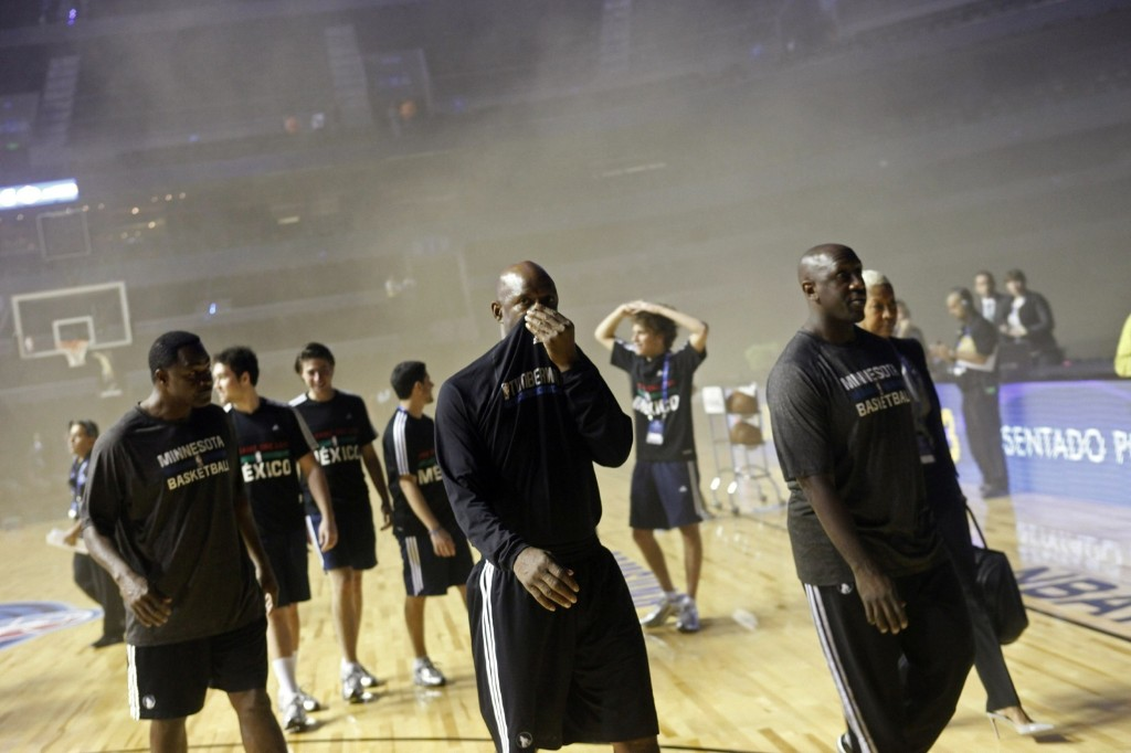 Minnesota Timberwolves players walk off the court amidst smoke after a transformer exploded at the Mexico City Arena Wednesday. The incident forced the cancellation of the NBA game against the Spurs. REUTERS/Edgard Garrido