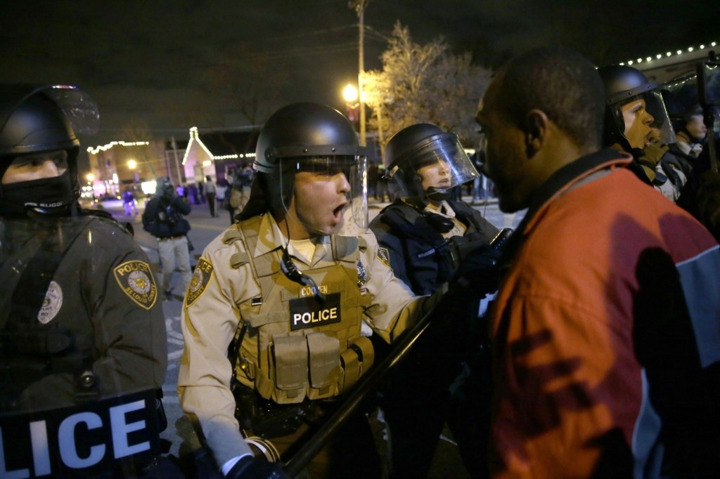 Police officers confront protesters in Ferguson, Mo. AP Photo/David Goldman