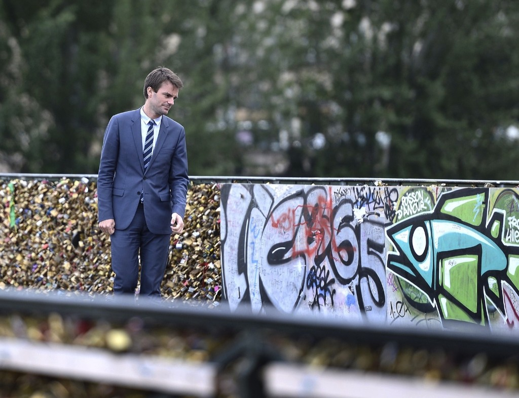 Paris Deputy Mayor Bruno Julliard stands on the Pont des Arts bridge during the removal of love padlocks attached on the railings of the bridge Monday, in Paris. Stephane de Sakutin/AFP/Getty Images