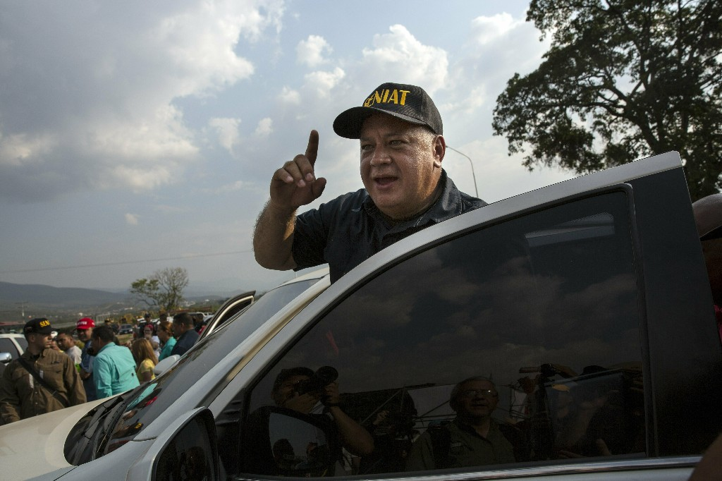 """Diosdado Cabello, President of Venezuela's Constituent Assembly, talks to supporters during the first day of the """"Hands off Venezuela"""" three-day music festival at the Tienditas International Bridge, in Urena, Venezuela, Friday, Feb. 22, 2019, on the border with Colombia. Venezuela's power struggle is set to convert into a battle of the bands Friday when musicians demanding Nicolas Maduro allow in humanitarian aid and those supporting the embattled leader's refusal sing in rival concerts being held at both sides of a border bridge where tons of donated food and medicine are being stored. (AP Photo/Rodrigo Abd)"""