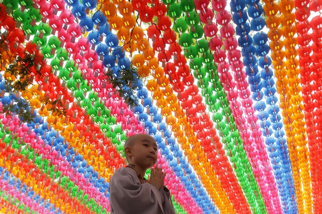 A child prays during the 'Children Becoming Buddhist Monks' ceremony in Seoul. Chung Sung-Jun/Getty Images